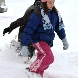 Photo of children snowshoeing
