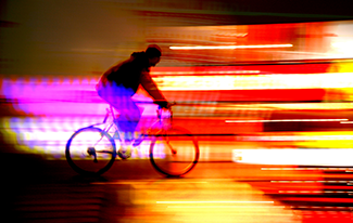 Biking At Night with Bright Blurry Lights