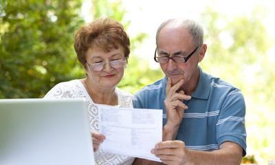 Senior couple w/ computer