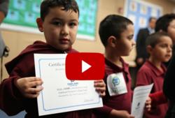 Boy holding K2C certificate
