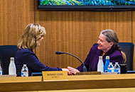 Photo of Supervisor Bonnie Gore and supervisor Jennifer Montgomery shaking hands.