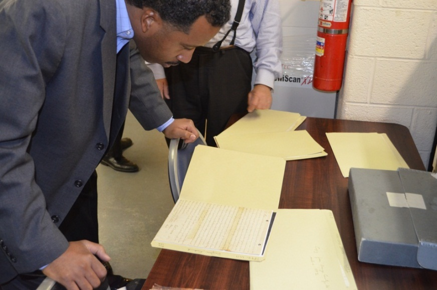 Councilmember McDuffie examines Frederick Douglass' will at the DC Archives