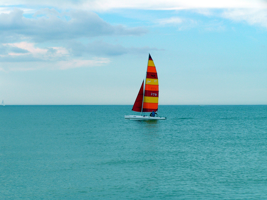A sailboat along the crystal blue water's of Florida's most popular state park, Honeymoon Island. Photo Credit: Christina Rueb