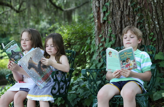 Children read in the shade at Alfred B. Maclay Gardens State Park in Tallahassee.