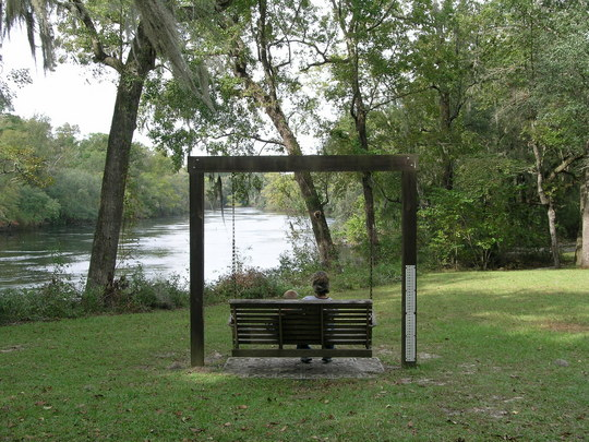 People enjoy a swing along the beautiful Suwannee River. 