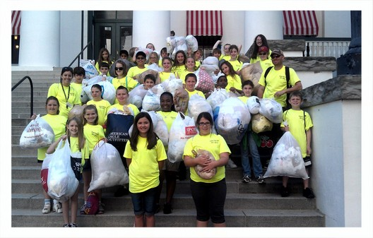 Students collect plastic bags for recycling.