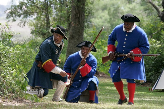 Living historians reenact the Battle of Bloody Mose.