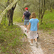 Two people hike at Alafia River State Park.