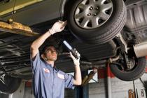 auto mechanic fixing tires