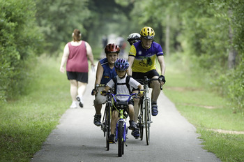 riders on the Tallahassee-St. Marks Trail, part of the Capital City to Sea Trails.
