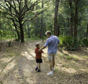 Man and boy hike in the Cross Florida Greenway
