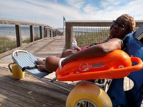 Gerri in the floating beach wheelchair, by Liz Sparks