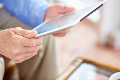 Senior on iPad