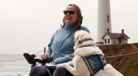 Lady in wheelchair with a seeing eye dog
