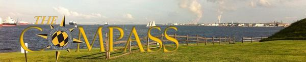 Compass Logo with Harbor Panarama in Background