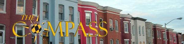 Image of West Baltimore rowhomes with Compass Logo