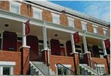 Image of Violet Ave Row Homes After Renovation