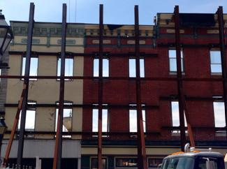 Picture of Fells Point Facades standing alone with sky showing through windows