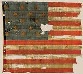Photo of original flag flown over Fort McHenry in Battle of Baltimore while at Smithsonian