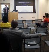 Image of Planner Travis Pate presenting to Students at Morgan State