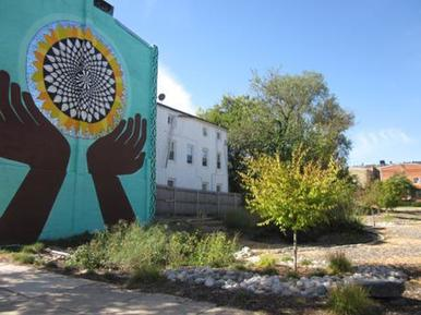 Image of Growing Green Lot with Art Mural