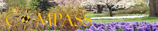 Sherwood Gardens in Bloom behind Compass Logo