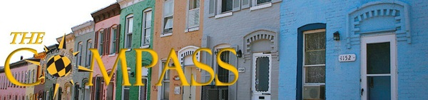 Photo of Colorful Baltimore Row Houses w/Compass Logo