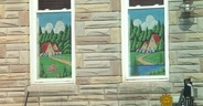 Photo showing two Baltimore painted window screens