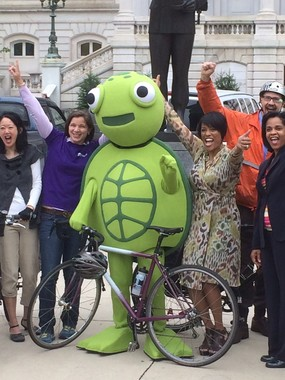 Turtle and the Mayor leading a Cheer on Bike to Work Day