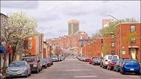 Image of residential street with view of downtown