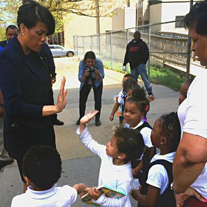 IMAGE: Mayor Rawlings-Blake and a young girl give each other a high five