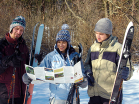 Photo of skiiers looking at map