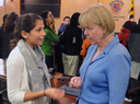 Nancy Floreen talking to student