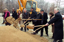 Elected officials shoveling dirt at groundbreaking ceremony