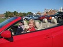Nancy Floreen with her dog in a convertible.