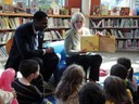 Nancy Floreen and Craig Rice reading to children.