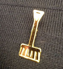 golden shovel lapel pin
