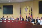 All nine Council members raising their hands.