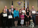 Nancy Floreen and Golden Shovel award winners and a service dog