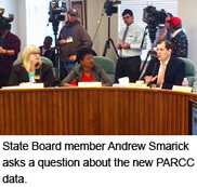 State Board memberAndrew Smarick asks a question about the new PARCC data.