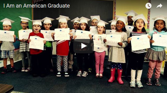 children hold signs for American Graduate