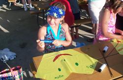 Girl making a kite