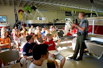 A Michigan conservation officer conducts a boating safety class in Commerce Township.