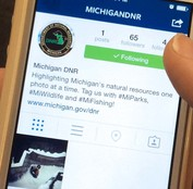 Smartphone displaying Michigan DNR Instagram profile