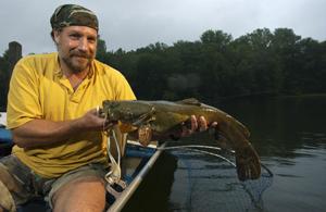 Angler holding a flathead catfish