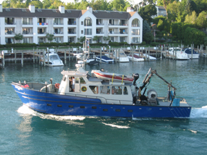 DNR survey vessel (S/V Steelhead) takes to Lake Michigan