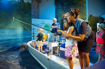 woman and child using the OAC fishing simulator