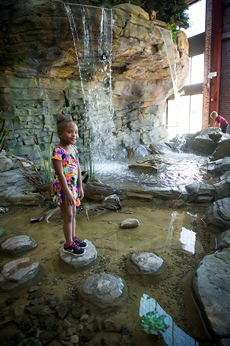 child in waterfall at OAC