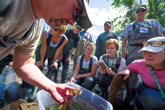 DNR biologist holding a crayfish for teachers