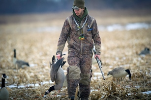 Hunter with a goose